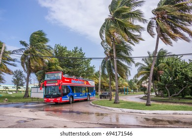 HAVANA, CUBA - JANUARY 14, 2016: Tourist bus touring the coast area of ??the city, on a rainy and windy day