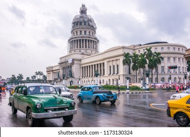 Havana, Cuba - january 15, 2016: Vehicle traffic on the Marti promenade with the Capitol building in the background, after a rainy day