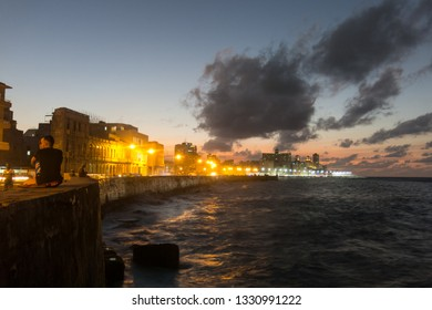 HAVANA, CUBA- JANUARY 15 2017: Sunset at Malecon, the famous Havana promenades where Habaneros, lovers and most of all individual fishermen meet, Havana, Cuba