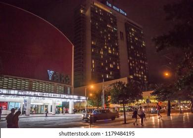 Havana, Cuba - january 16, 2016: Low-light night scene of the Yara cinema and the Habana Libre Hotel, on the twenty-third avenue of the city center