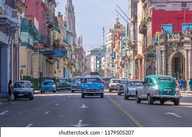 Havana, Cuba - january 16, 2016: Intense traffic of old American vehicles on Simon Bolivar Avenue in the urban center of the city