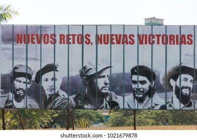 "HAVANA, CUBA - JANUARY 16, 2017: The propaganda poster ""New propaganda, new victories"" with faces of famous revolutionaries such as Fidel Castro, Cienfuegos, Che Guevara or Raul Castro. Havana, Cuba."