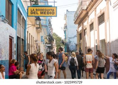 HAVANA, CUBA - JANUARY 16, 2017: Bar La Bodeguita del medio, on Obispo street. Tourists walking in a daily scene in Old Havana, on a sunny day. Havana, Cuba