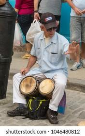 HAVANA, CUBA - JANUARY 16, 2017: Street musician perform for tourists and tips in Old Havana, Havana, Cuba