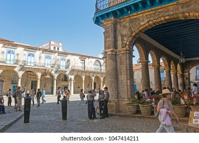 HAVANA, CUBA - JANUARY 16, 2017: Tourists at the Cathedral Square on a beautiful day. Old Havana, Cuba. In this square is the cathedral, the Colonial Art Museum and the Archeology Museum. Cuba