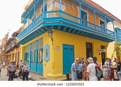 HAVANA, CUBA - JANUARY 16, 2017: Tourists walking in a daily scene in Old Havana, on a sunny day. Havana, Cuba