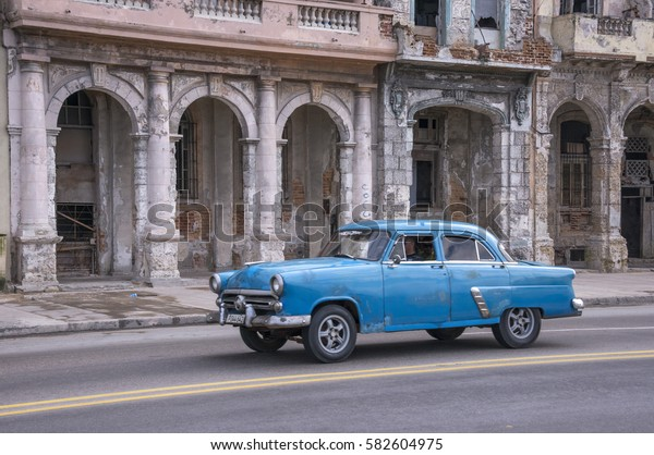HAVANA, CUBA - JANUARY 20, 2016: Motion blur of an old American car, on its way past the old mansions of the Malecon