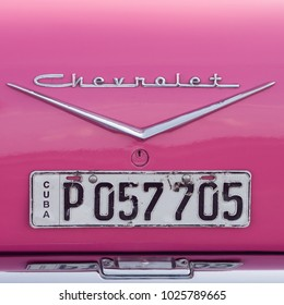 Havana, Cuba - January 31, 2018: Detail of a classic pink Chevrolet in Havana, Cuba. Recent law allows Cubans to trade cars, the former law resulted in an old fleet of private owned cars from the 50's