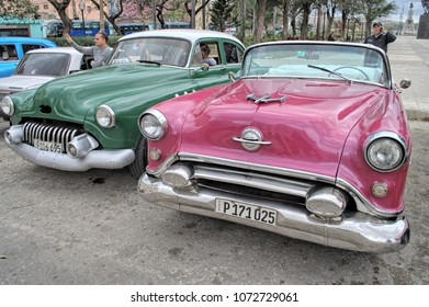 HAVANA, CUBA - January 4, 2018: Vintage classic cars parked on the street.