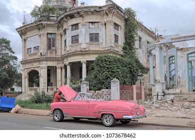 HAVANA, CUBA - January 4, 2018: Vintage classic car on the background of ruined colonial architecture.
