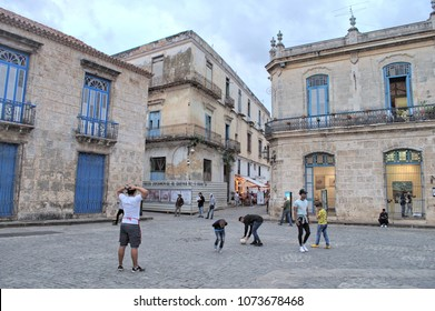 HAVANA, CUBA - January 4, 2018: Youth playing football on the historic Plaza de la Catedral.