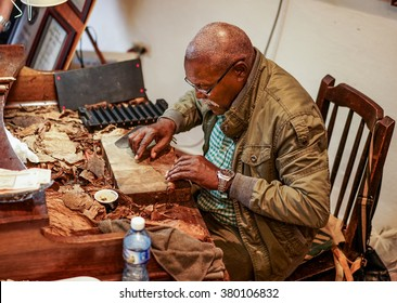 Havana, Cuba - January 8, 2016: The famous cigar-maker Jose Castelar Cairo, better known as el Cueto, about to roll a cigar