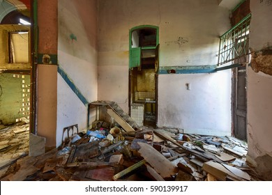 Havana, Cuba - January 8, 2017: Old building in the process of collapsing in the Old Havana neighborhood of Havana, Cuba.
