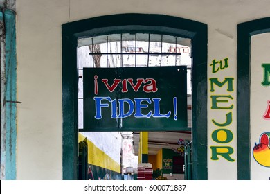 """Havana, Cuba - January 8, 2017: Entrance to a fruit stand in Old Havana, Cuba with the words """"Live Fidel!""""."""