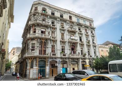 Havana, Cuba - Jul 2, 2016: Dilapidated building in the city center held up by stilts