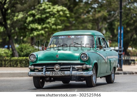 HAVANA, CUBA - JULY 05, 2015: HDR green american Oldtimer drive on the street at the Malecon.