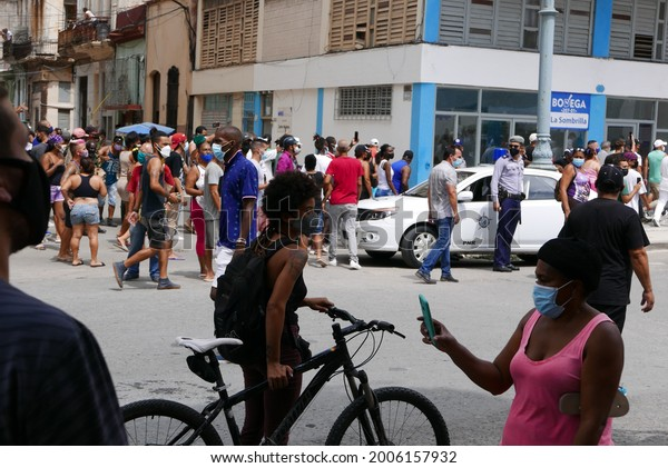 Havana, Cuba - July 11, 2021 : rare  protest in Havana, Cubans crying for freedom and revolutionaries defending president Diaz-Canel