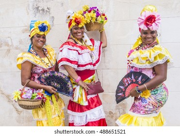 HAVANA, CUBA - JULY 18 : Cuban women with traditional clothing in old Havana street on July 18 2016. The historic center of Havana is UNESCO World Heritage Site since 1982.