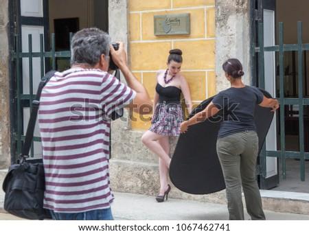 12ab5dd3 Havana, Cuba - July 2 2013: A photographer takes a photograph of a model