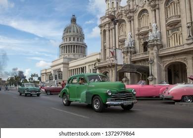 Havana, Cuba - July 30, 2017:  Vintage car driving in from of the capital building in Havana, Cuba.