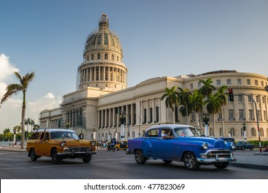 HAVANA, CUBA - JULY 7, 2016: Old American cars drive past the Capitol building in Havana, Cuba.