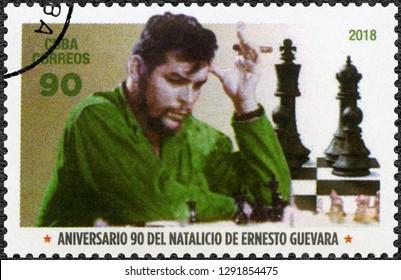 HAVANA, CUBA - JUNE 14, 2018: A stamp printed in Cuba shows commander Ernesto Guevara de la Serna Che Guevara (1928-1967) and chess, 2018
