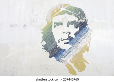 HAVANA, CUBA - JUNE, 2011: Graffiti stencil of revolutionary icon Che Guevara features stripes of color on a textured wall.
