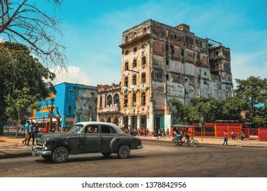 HAVANA, CUBA - June 2015 : Street scene with old cars and colorful buildings in Old Havana