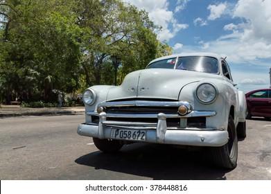 HAVANA, CUBA - JUNE 23, 2015: Front view of an old cuban car parked in Old Havana.