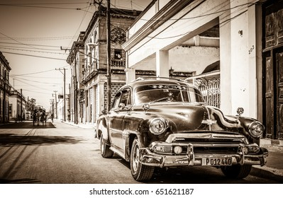 HAVANA, CUBA - JUNE 27, 2015: HDR - Streetlife view with a american Chevrolet classic car on the street in the suburb from Havana Cuba - Retro Serie Sepia Cuba Reportage