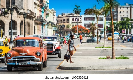 Havana, Cuba - June 27, 2017: HDR - Street life view on the main street with american brown Chevrolet classic car in Havana City Cuba - Serie Cuba Reportage