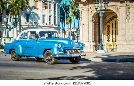 Havana, Cuba - June 27, 2017: HDR - American blue classic car with white roof drived on the main street in Havana City Cuba - Serie Cuba Reportage