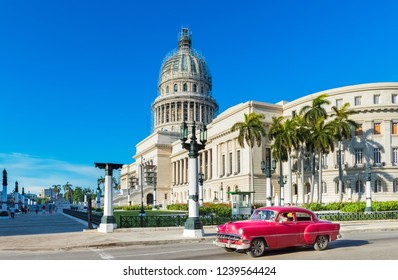 Havana, Cuba - June 27, 2017: Street life view with peoples on the street an american a brown red Chevrolet vintage car drive before the Capitolio on the main street in Havana City Cuba - Serie Cuba