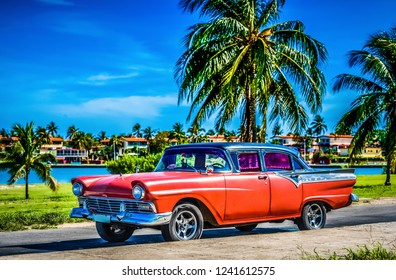Havana, Cuba - June 30, 2017: American red Ford classic car parked under blue sky near the beach in Havana Cuba - Serie Cuba Reportage