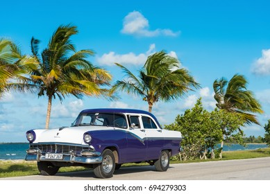 Havana, Cuba - June 30, 2017: Parked american blue white Ford Fairlane vintage car near the beach in a suburb from Havana Cuba - Serie Cuba Reportage