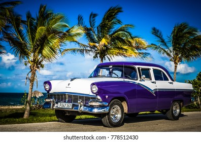 Havana, Cuba - June 30, 2017: American blue Ford Fairlane classic car parked on the Malecon before the beach in Havana Cuba - Serie Cuba Reportage