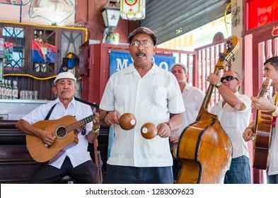 Havana, Cuba - June 6 2014: Cuban band performing live music in a bar in Havana, Cuba. Cuban streets performers. Salsa, cuba.