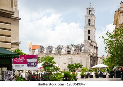 Havana / Cuba - June 6 2014:  Havana Cathedral Square with people, restaurants and bars in Havana, Cuba.
