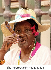 HAVANA, CUBA - JUNE 6, 2015: An old lady is smoking a big cigar