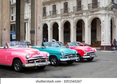 Havana, Cuba - March 11, 2018: Vividly colored classic cars in central Havana