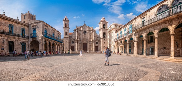 Havana, Cuba -March 13, 2016: Panoramic shot of Plaza de la Cathedral in Old Havana with the baroque architecture of San Cristobal Cathedral. Cobblestone paving and inviting colonnades are all around.