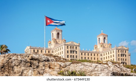 Havana, Cuba -March 14, 2016: Hotel Nacional in Havana, Cuba - View from the Malecon with Cuban flag.