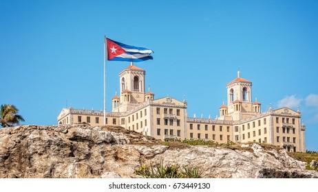 Havana, Cuba -March 14, 2016: Hotel Nacional in Havana, Cuba - View from the Malecon with Cuban flag.