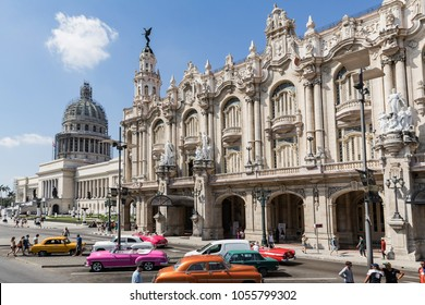 HAVANA, CUBA - MARCH 17, 2018. The Grand theatre of Havana on the Paseo del Prado in Havana. The Capitol on the back.Some people walk past the theater. Classic colors cars.