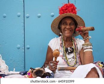 HAVANA, CUBA - MARCH 17 - Portrait of african cuban woman smoking cigar on March 17, 2016.