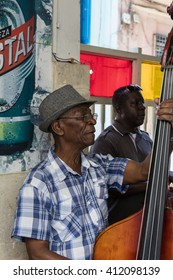 HAVANA, CUBA - MARCH 2, 2016: Musical group with bass player playing music in the bar in Old Havana