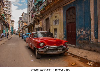 HAVANA, CUBA- MARCH 2018: Street scene with classic old cars and traditional colorful buildings in downtown Havana.
