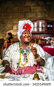 Havana, Cuba - March 21 2019: Cuban woman posing for photos while smoking big cuban cigar in La Habana, Havana, Cuba, West Indies, Caribbean, Central America