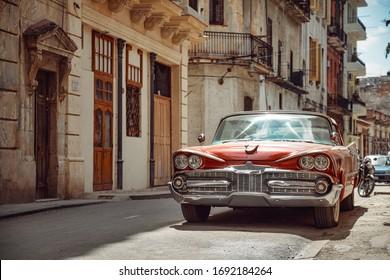 Havana, Cuba - March 22, 2019: Shiny retro car parked on the street