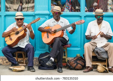 Havana, Cuba - March 24, 2017: Elderly street musicians playing traditional cuban music on the street in old Havana